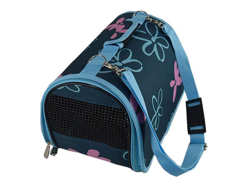 Bolso transportin elaborado con tela de nylon y decorado con flores sobre un fondo azul