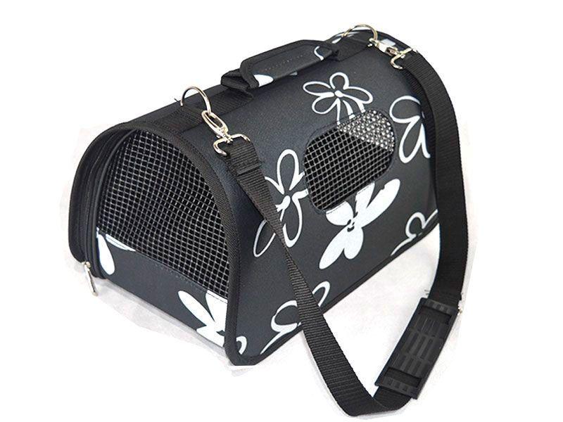 Bolso de viaje  para mascotas realizado en tela y con decoración de flores