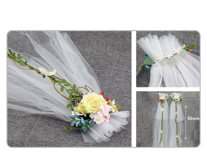 peineta con velo blanco y adorno floral en dos colores blanco o amarillo